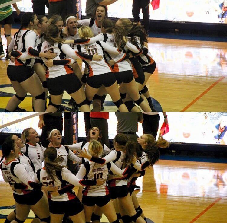 Varsity Volleyball team celebrates after their playoff win