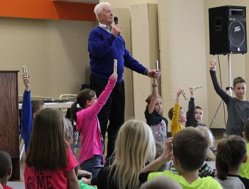 Elementary students draw for prizes at the fundraiser assembly