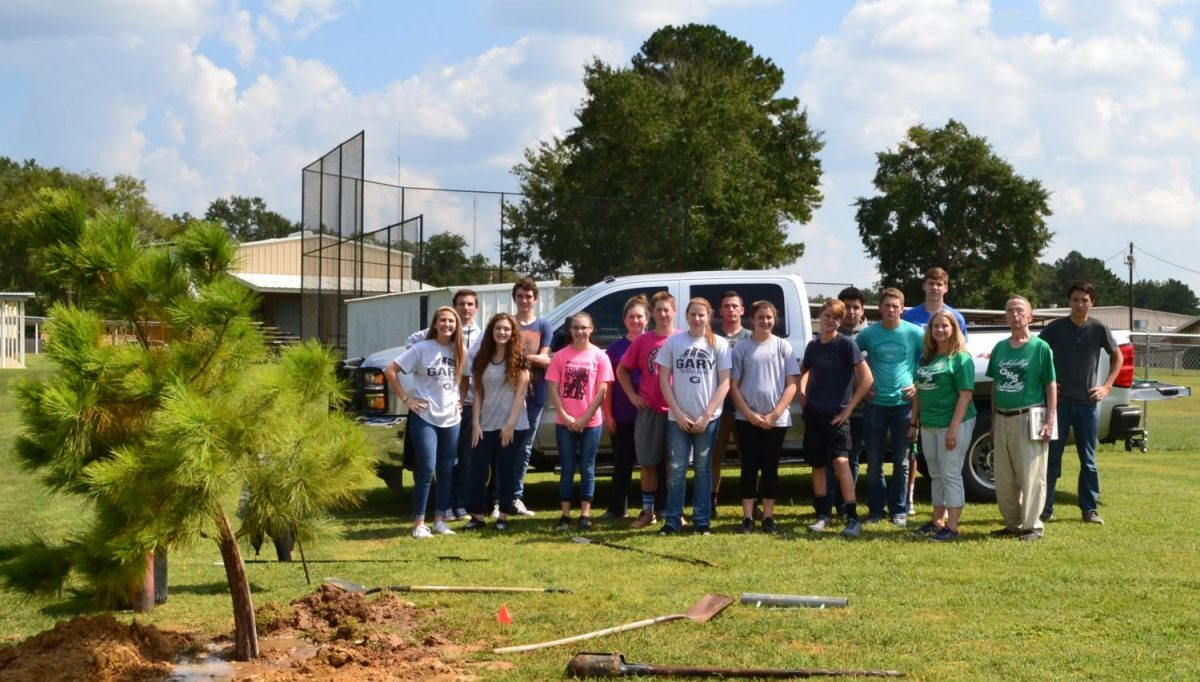 The Loblolly staff plants a pine tree in celebration of the magazine's return to print.                                                                                                                                                                                                                                               Loblolly Members: Sarolyn Musick, Matthew Nugent, Hannah Williams, Ryan Shelton, Valerie Stuart, Jaymee Thornton, Colton Standard, Briley Edwards, Brenton Humphries, Kaylee Dawson, Zach Spradley, Victor Hernandez, Cameron Sudweeks, Cade Coligan, Chandler Patty. Advisor, Nerissa Coligan, and Founder, Lincoln King.