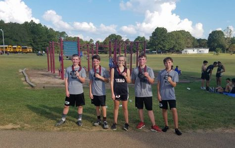 The Gary Junior High Cross Country team shows off their medals.