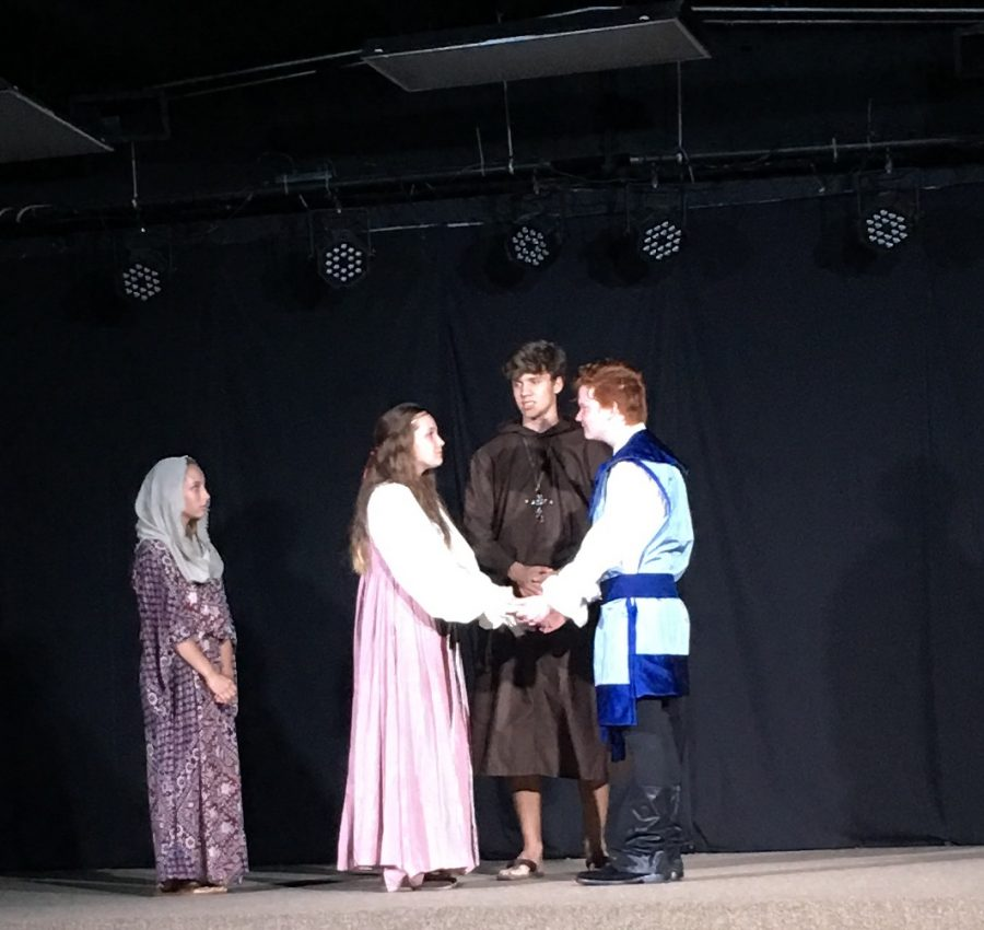Maddie Davis as the nurse looks on as Romeo, played by Dylan Essary, and Juliet, played by Morgan Fondren, are married by the Friar played by Cade Coligan.