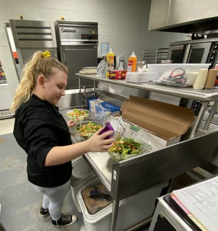 Hayley Dreymala prepares meal in culinary class.